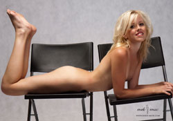 lou nude with black chairs